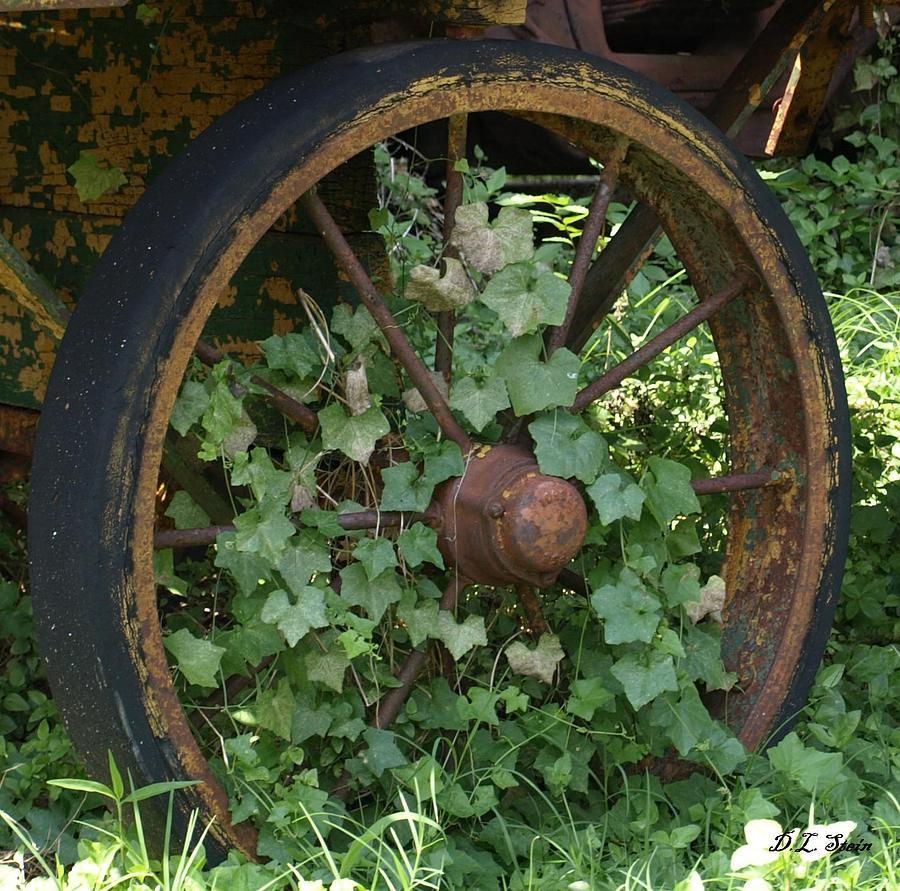 Wagon Photograph - Wagon Wheel by Dennis Stein