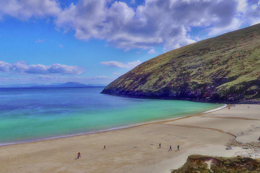 Achill Island Photograph - Walkers on Keem Beach, Achill Island feted by the green Atlantic Ocean. by Paul Mc Namara