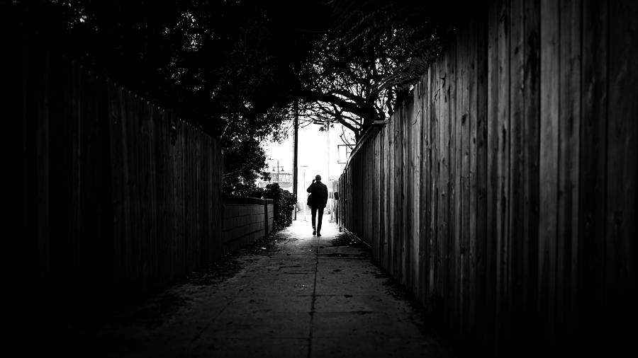 Alone photograph walking in venice beach los angeles united states black and