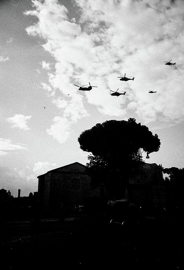 War helicopters over the Imperial Fora by Nacho Vega