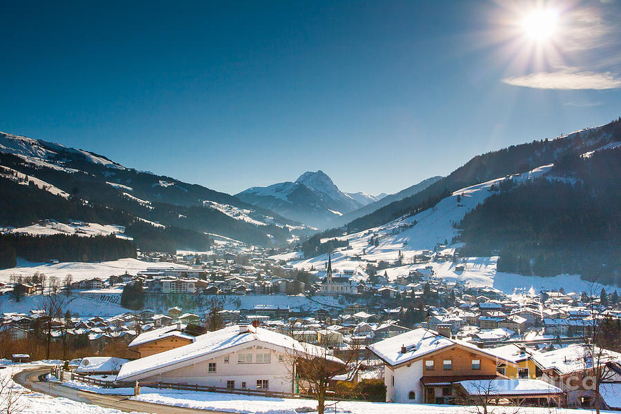 Warm winter day in Kirchberg town of Austria by John Wadleigh
