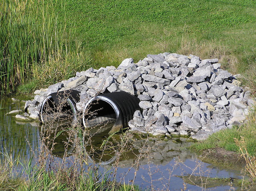 Water Photograph - Water And Culverts by Richard Mitchell