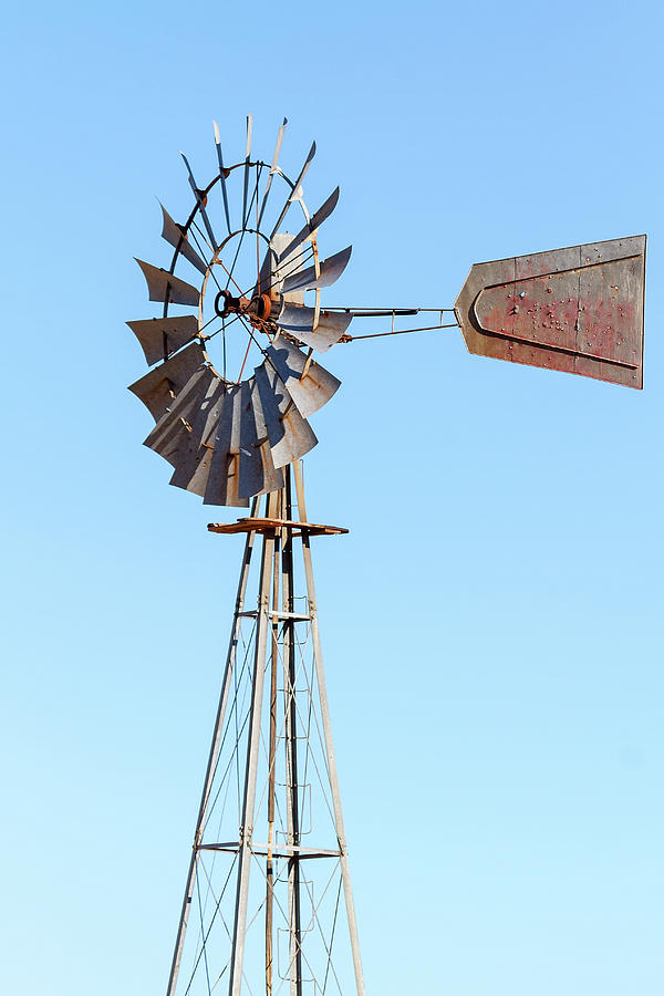 Windmill Photograph - Water Pump Windmill On Blue Sky Background by David Gn