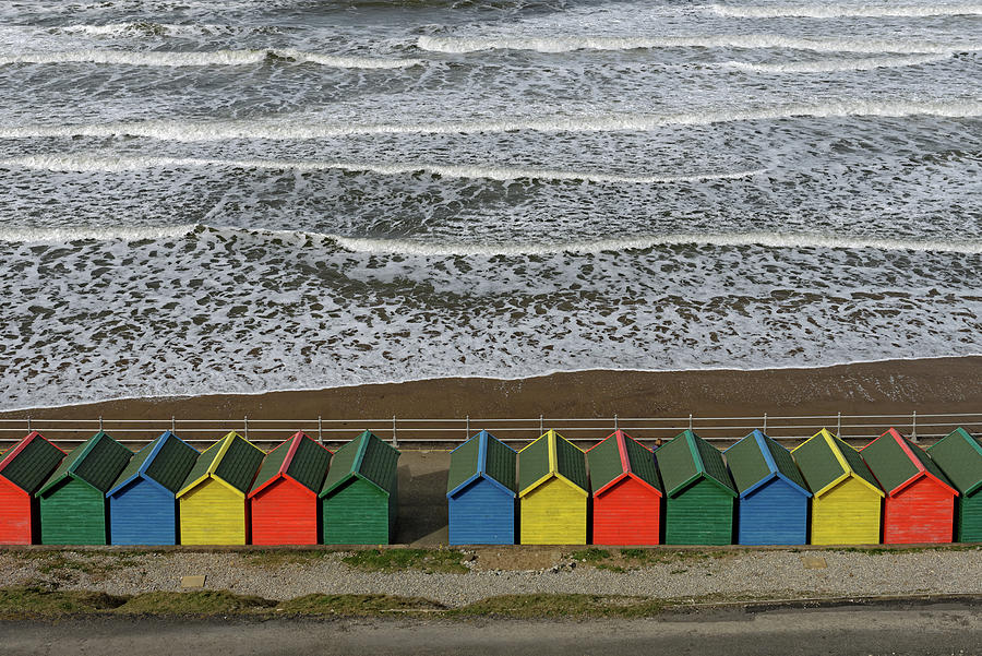 Britain Photograph - Waves And Beach Huts - Whitby by Rod Johnson