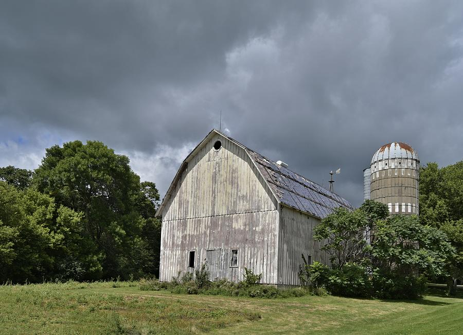Silo Photograph - Weathered Barn And Silo Under A Cloudy Sky by Steven Liveoak