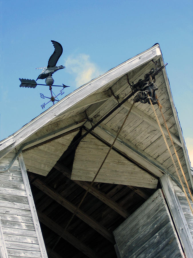 Weather Vane Photograph - Weathervane Over The Hay Loft by Laurie With
