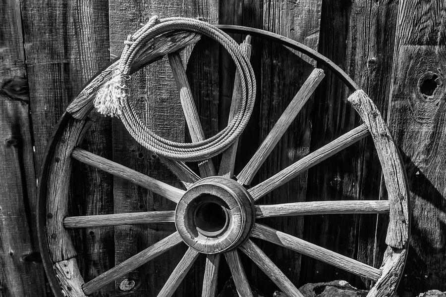 Broke Photograph - Western Rope And Wooden Wheel In Black And White by Garry Gay