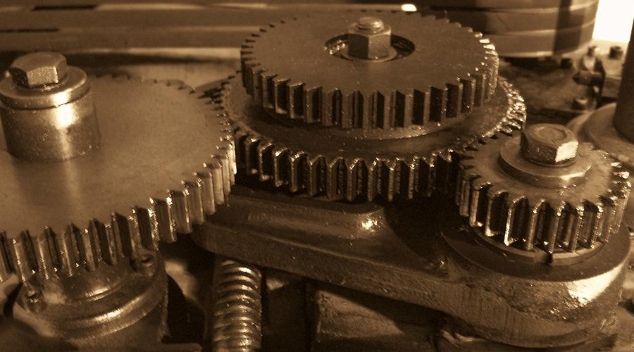 Gears Photograph - What Makes The World Go Around by Robert  Collier