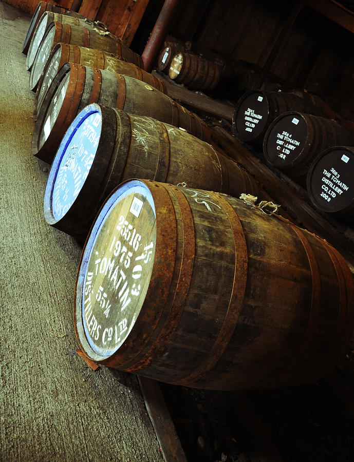 Whiskey Photograph - Whiskey Barrels at the Distillery by Caroline Reyes-Loughrey