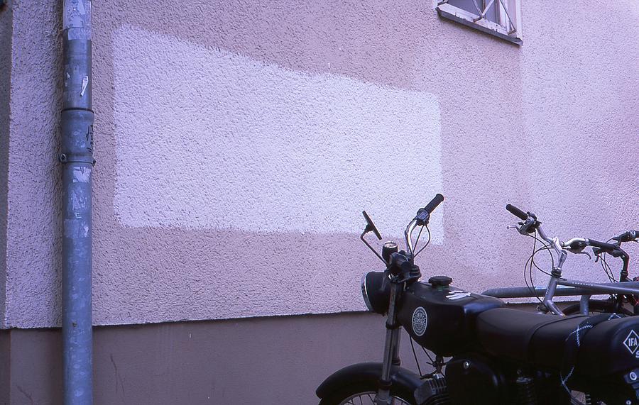 White Photograph - White rectangle and vintage bikes by Nacho Vega