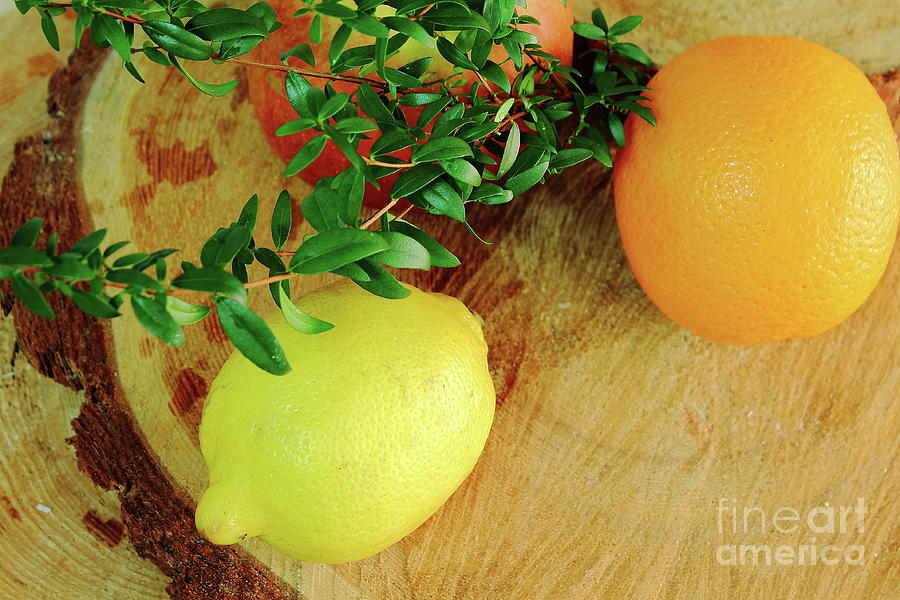 Whole Fruits Red Apple, Orange, Orange, Lemon Yellow Are On A Wooden Board, They Are Decorated With Branches Of Myrtle. Photograph