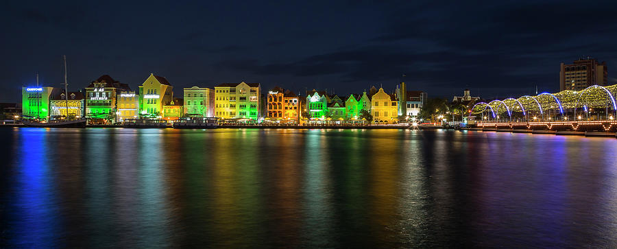 Willemstad and Queen Emma Bridge at Night by Adam Romanowicz