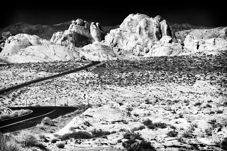 Road Photograph - Winding In The Desert by John Rizzuto