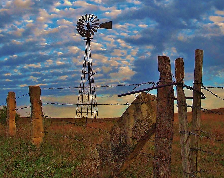 Windmill And Limestone Fenceposts In Kansas Photograph by