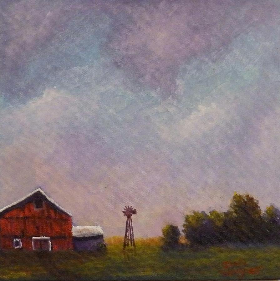 Windmill farm under a stormy sky. by Dan Wagner