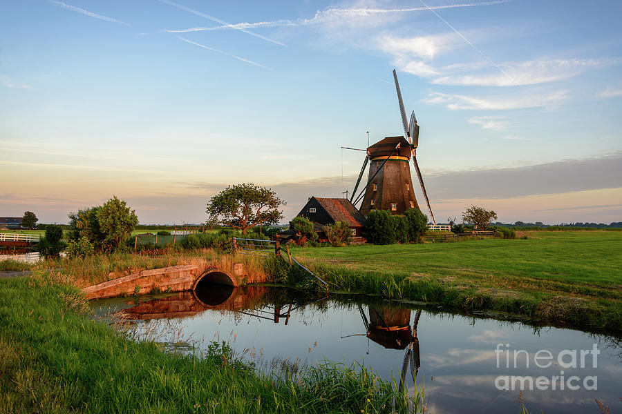 Windmill Photograph - Windmill in the countryside in Holland by IPics Photography