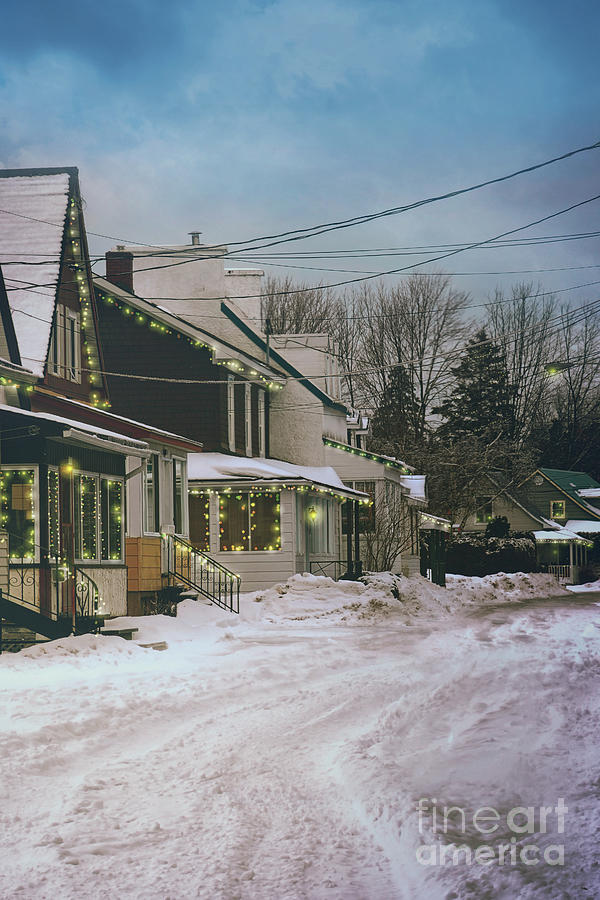 Winter scene of a row of houses with lights by Sandra Cunningham