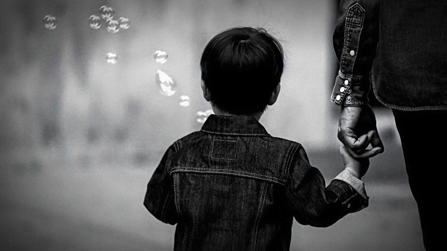 Father And Son Photograph - With Dad And Bubbles by Dieter Lesche