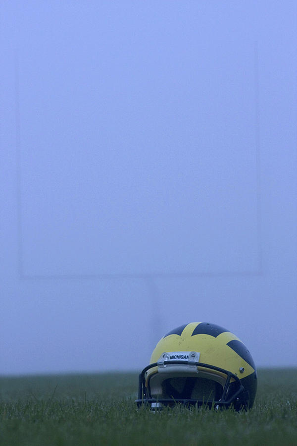 Wolverine helmet on the field in heavy fog by Michigan Helmet