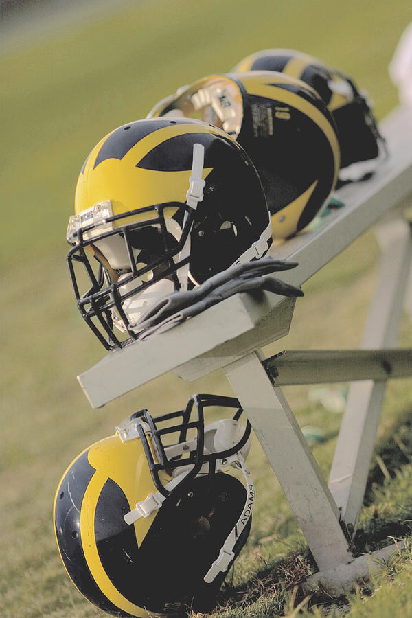 Wolverine Helmets on a Football Bench by Michigan Helmet