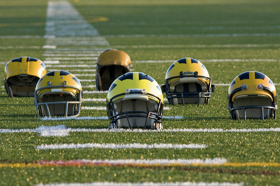 Wolverine Helmets Throughout History on the Field by Michigan Helmet
