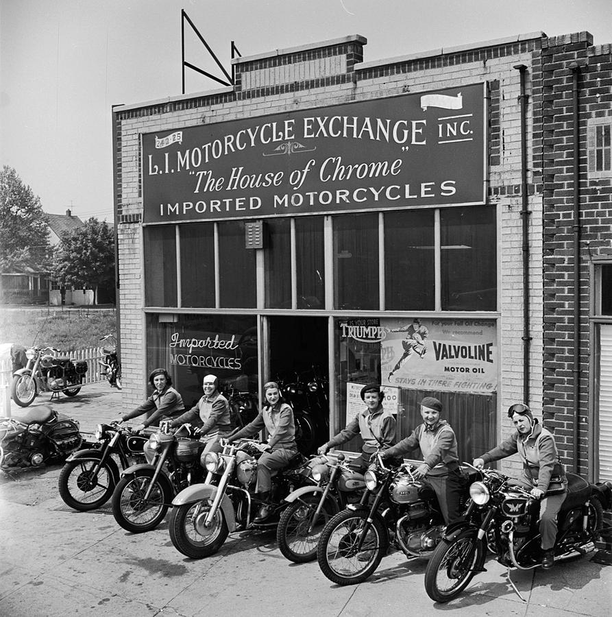 The Motor Maids of America outside the shop they used as their headquarters, 1950. by LAWRENCE CHRISTOPHER