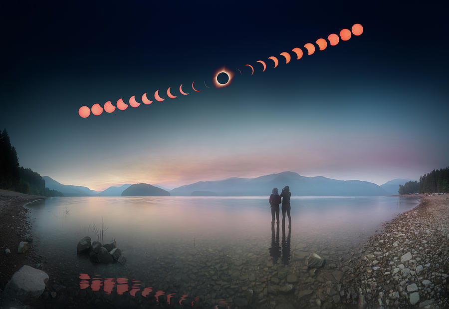 2017 Photograph - Woman And Girl Standing In Lake Watching Solar Eclipse by William Freebilly photography