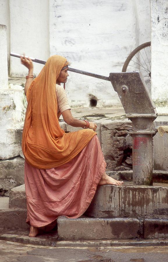 India Photograph - Woman At The Pump by Dray Van Beeck
