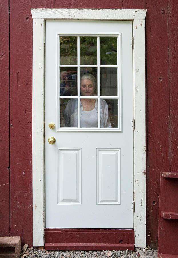 Woman Behind Door Photograph