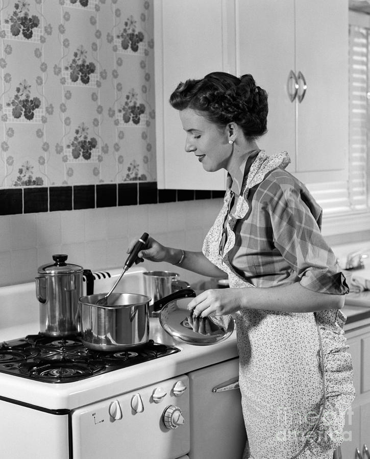 Woman Cooking On Stovetop, C.1950s Photograph by H ...