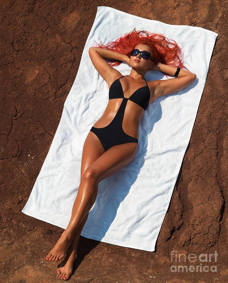 Sunbathing Photograph - Woman Sunbathing by Oleksiy Maksymenko