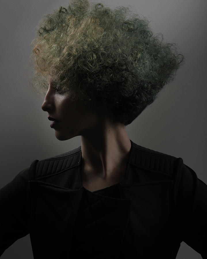 Woman With Green And Blonde Hair Color In Big Hair Perm Photograph