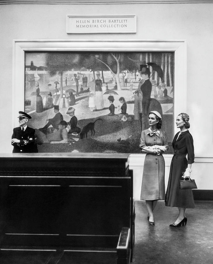 Women View Seurat Painting In Museum Photograph by Horst P Horst