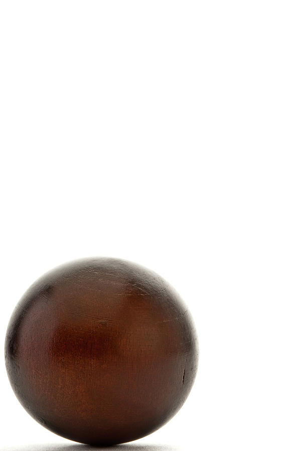 Wooden Ball In A Corner Photograph