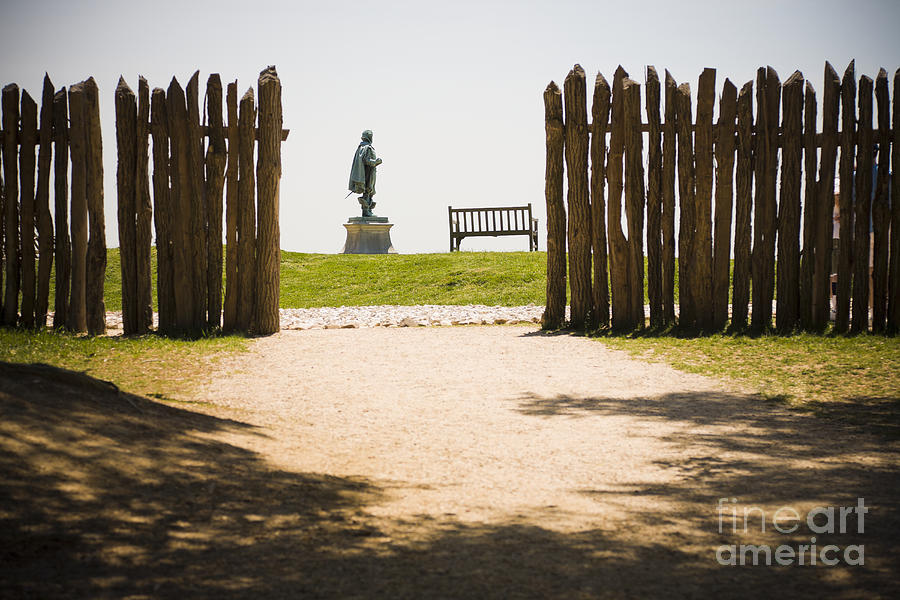 Barricade Photograph - Wooden Fence And Statue Of John Smith by Roberto Westbrook