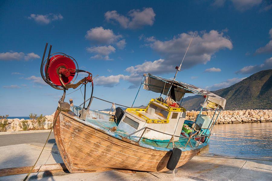 Boat Photograph - Wooden Fishing Boat On Shore by Iordanis Pallikaras