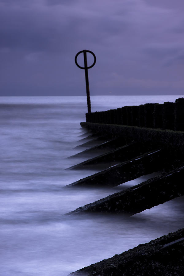 Beach Photograph - Wooden Groynes Of Aberdeen Scotland by Gabor Pozsgai