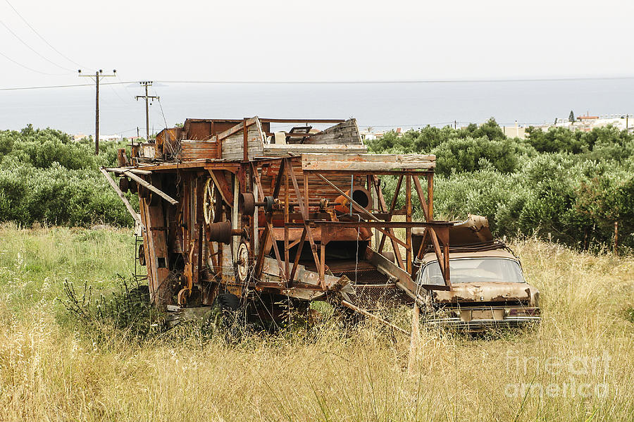 Worn Photograph - Worn Out Harvester And Car by Kim Lessel