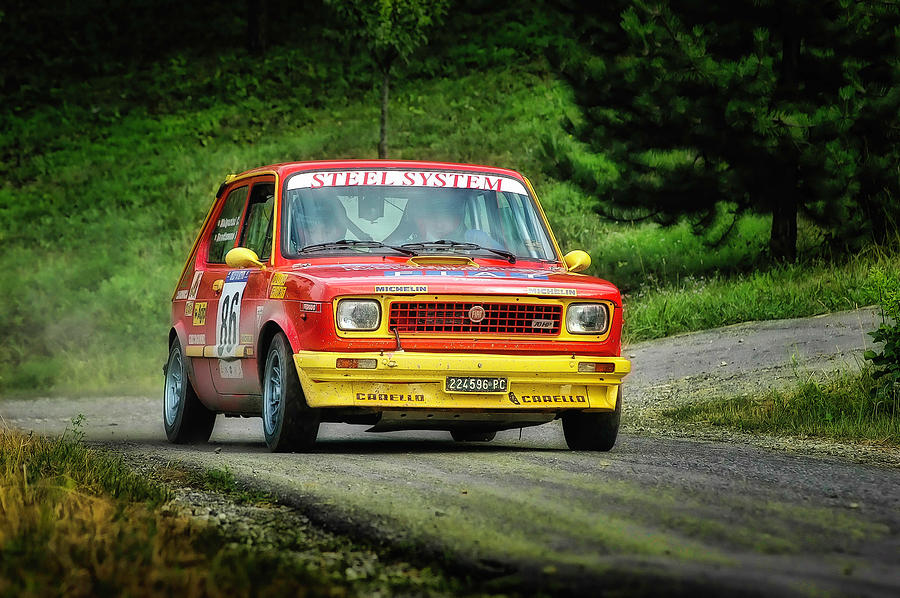 Car Photograph - Yellow And Red Fiat 127 by Alain De Maximy