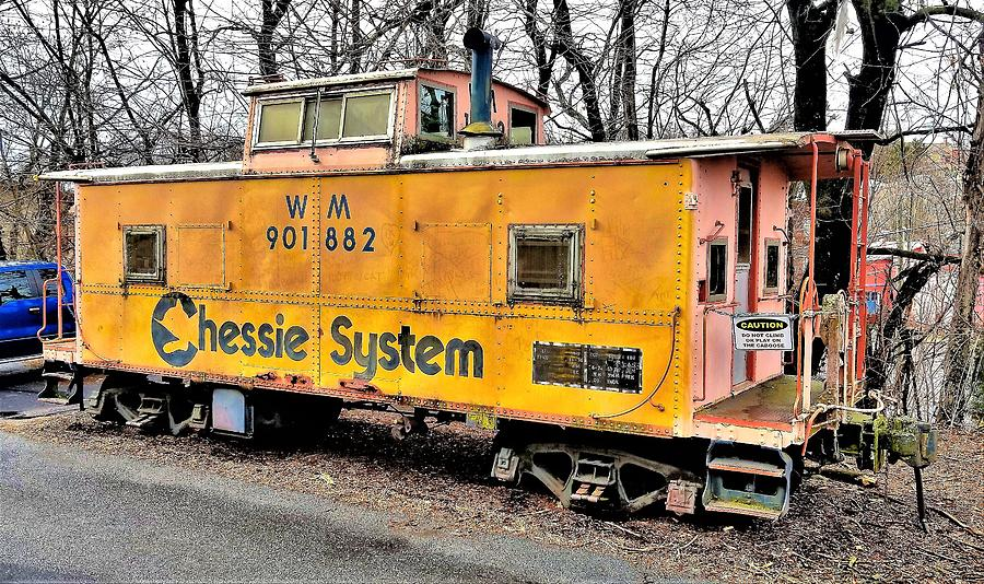 Yellow Chessie Caboose by Jim Harris