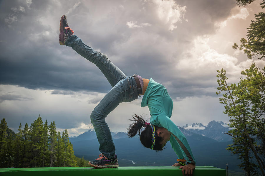 Young Asian Girl In Bridge Pose At Lake Louise Area Photograph