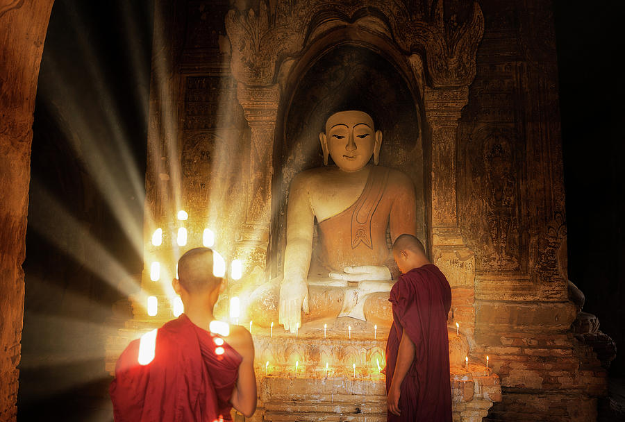 Asia Photograph - Young Buddhist Monk Are Reading With Sun Light by Anek Suwannaphoom