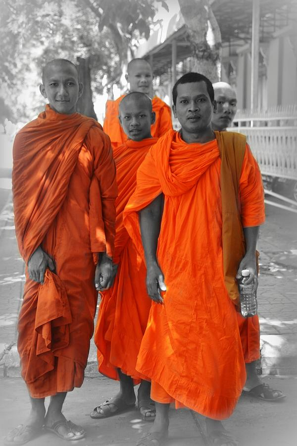 Young Buddhist Monks In Orange Robes