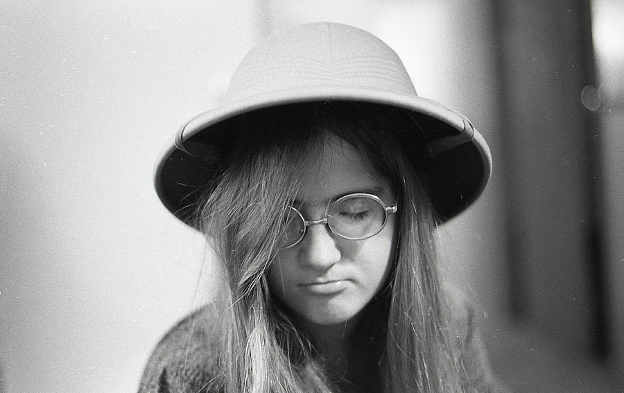 Young Woman with Long Hair, Wearing a Pith Helmet, 1972 by Jeremy Butler