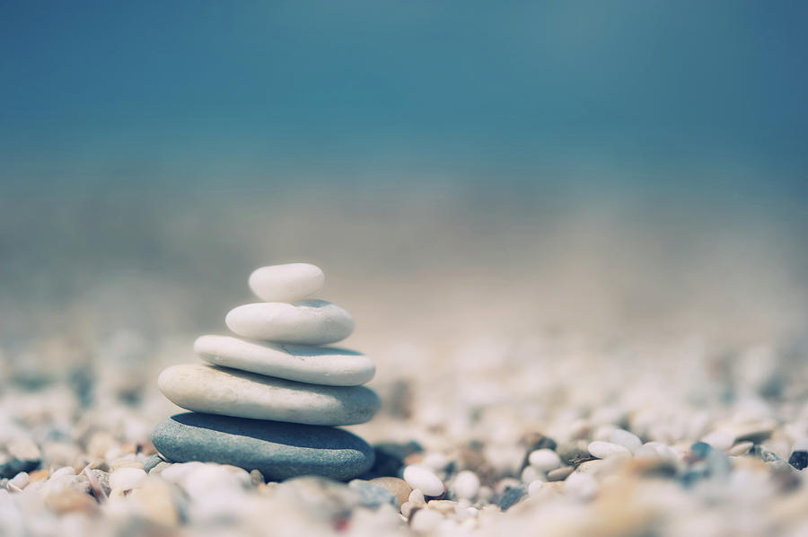 Horizontal Photograph - Zen Balanced Pebbles At Beach by Alexandre Fundone