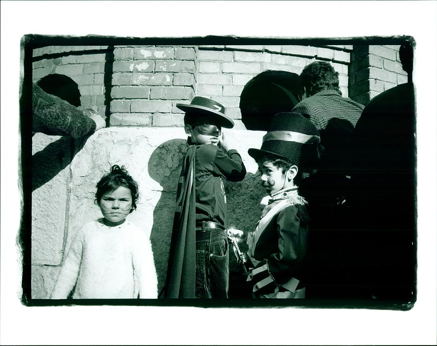 Costumes Photograph - Zorro And Cat Girl by Lynn Friedman