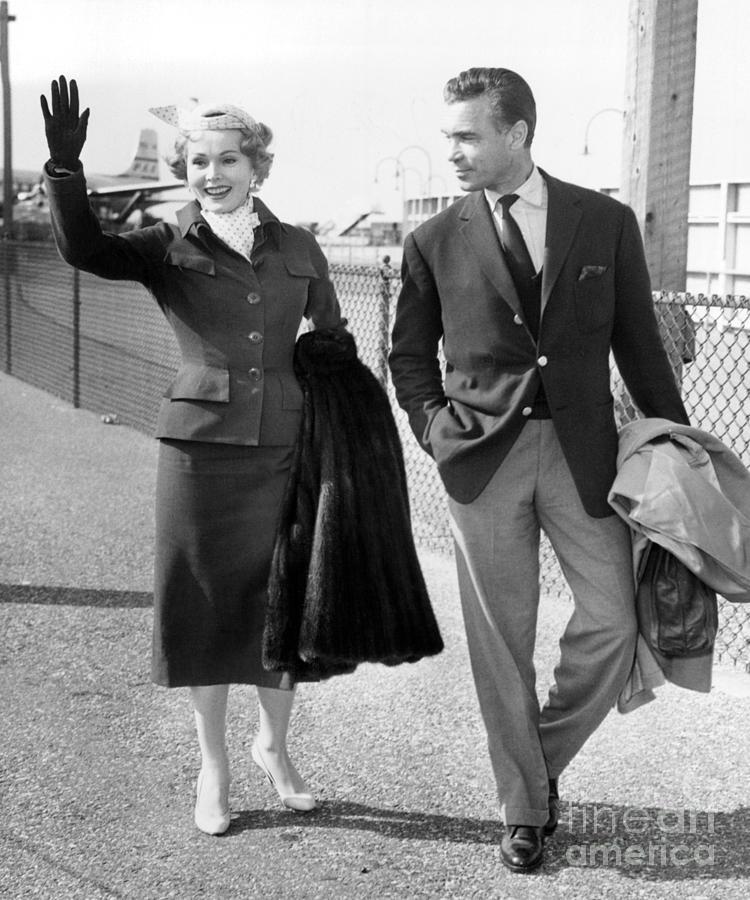 Zsa Zsa Gabor And Porfirio Rubirosa Arrive At Idlewild Airport From Ireland. 1954 Photograph by Barney Stein
