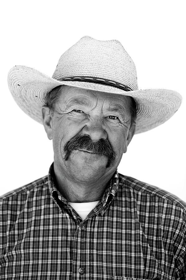 A Black And White Portrait Of A Cowboy Photograph by Rachid Dahnoun