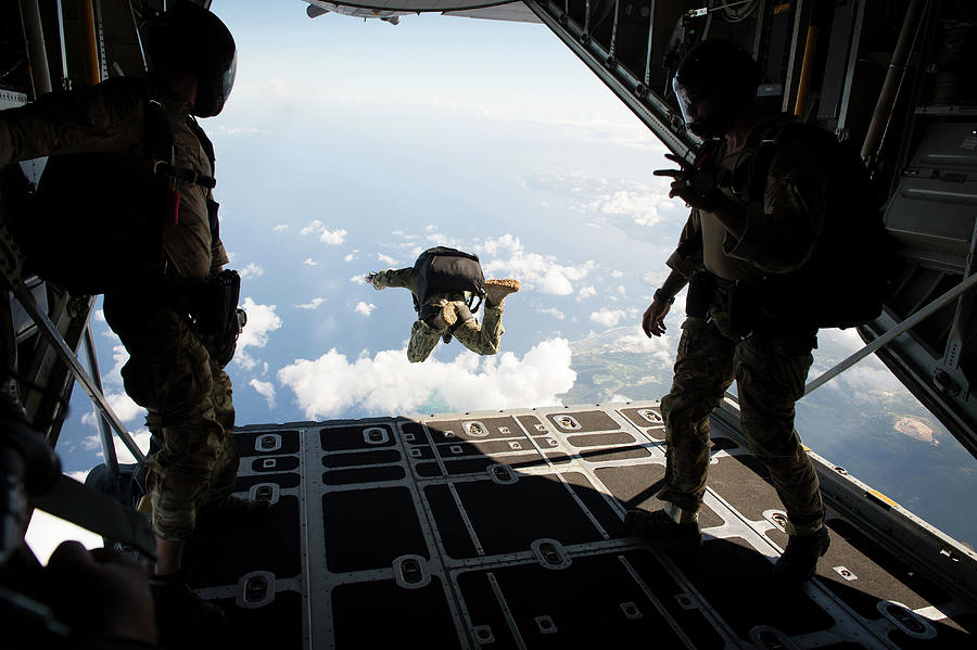 Guam Photograph - A Free Fall Jump From A C-130 Hercules 1 by Stocktrek Images