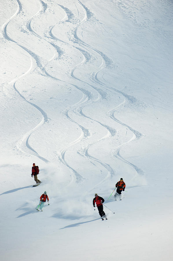 A Group Of Backcountry Skiers Follow Photograph by Doug Marshall